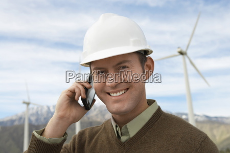 engineer using mobile phone at wind
