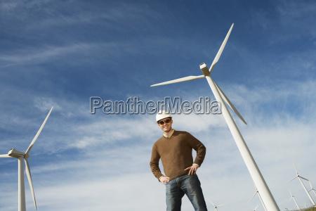 engineer wearing hardhat at wind farm