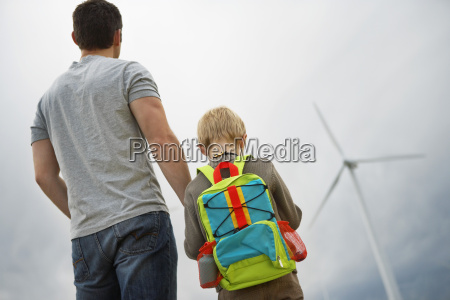 father and son at wind farm
