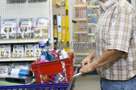midsection of man with shopping cart