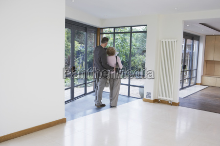 couple observing new property