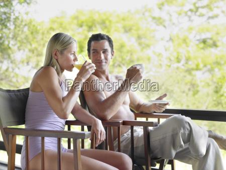 couple drinking tea and juice on