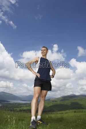 male hiker on grassland