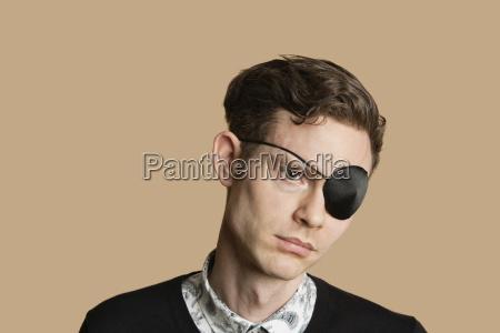 sad mid adult man wearing eye