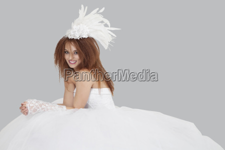 portrait of happy young bride sitting