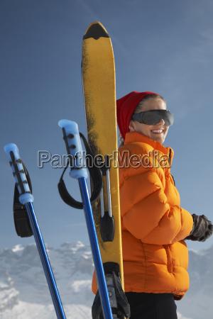 woman in winter jacket by ski