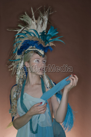 beautiful young woman wearing costume with
