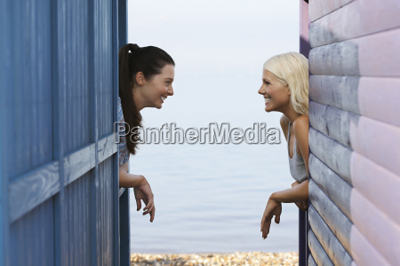 female friends leaning on balustrade of