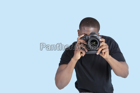 african american young man taking photo