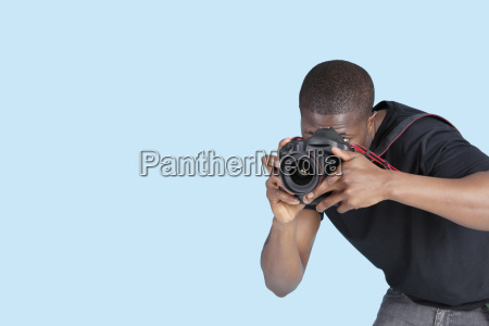 young man taking photo through digital