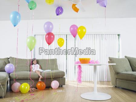 girl sitting in living room full