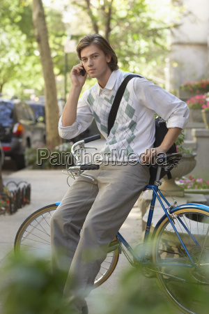 businessman using cell phone while sitting