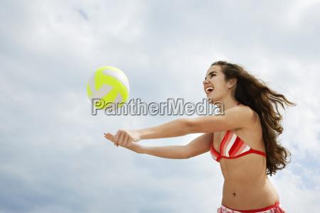 teenage girl in bikini playing beach