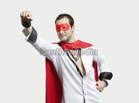 young man wearing superhero costume against