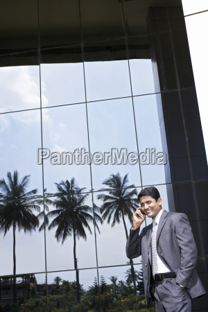 businessman using cell phone outdoors