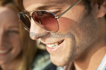 smiling young man wearing sunglasses