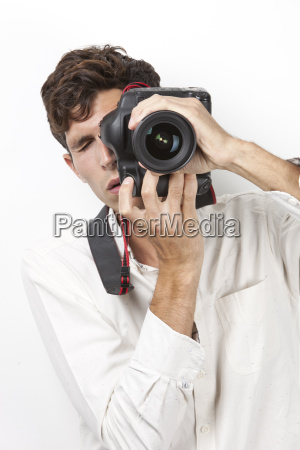 young man taking photograph with vintage
