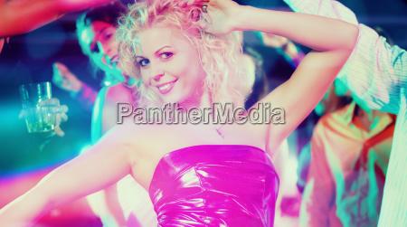 girl dancing in disco club celebrating