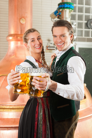 man and woman with beer glass
