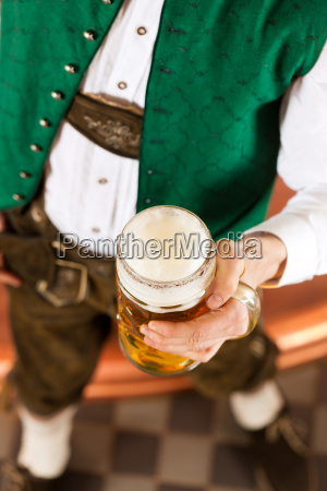 man with beer glass in brewery
