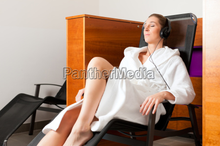 young woman relaxing in spa with