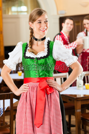 young people in traditional bavarian tracht