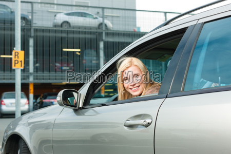 woman back her car on a