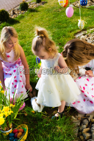 children on easter egg hunt with