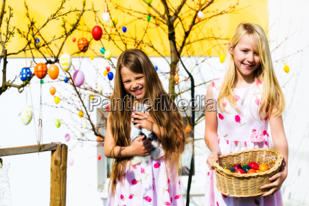 girl on easter egg hunt with