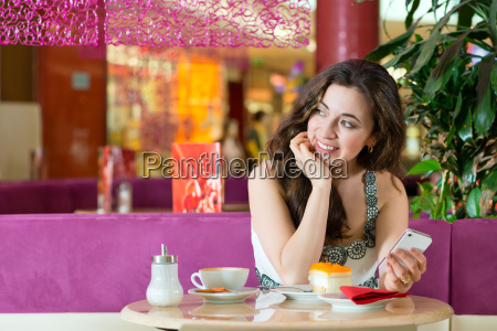 young woman in ice cream parlor