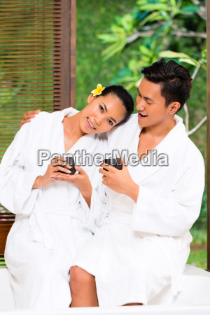 indonesian asian couple drinking tea in