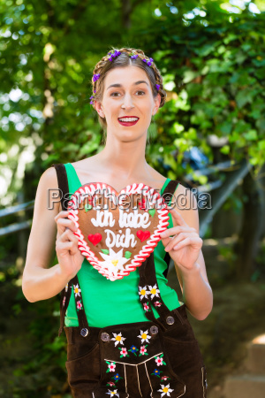 woman with gingerbread hart in bavaria