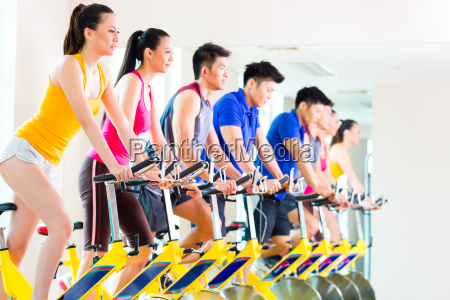 asian people in spinning bike training