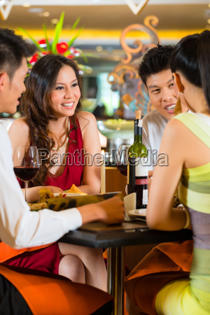 chinese business people dining in elegant
