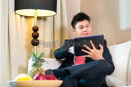 businessman in asian hotel room working