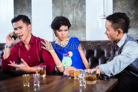 asian man harassing woman in fancy