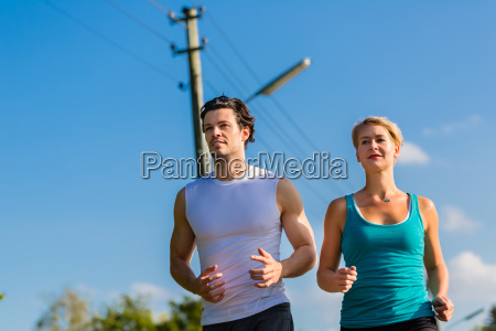 sport couple running and jogging on
