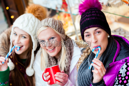 friends with eggnog and candy sticks