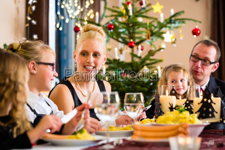 family having christmas dinner sausages