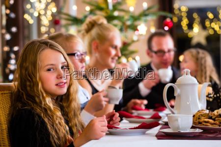 family having traditional christmas coffee time