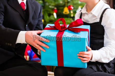 family giving presents on christmas day