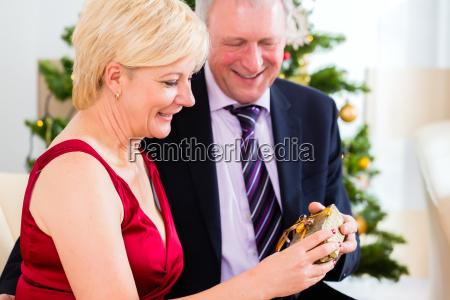 senior couple celebrating christmas eve