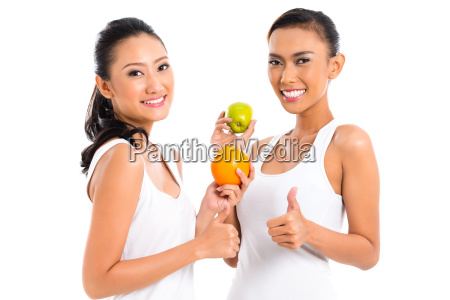 asian friends eating fruit living healthy