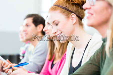 students in college learning