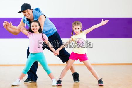 dance teacher giving kids zumba dancing