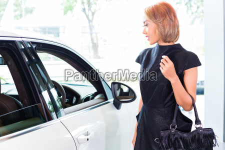 asian indonesian woman buying suv car