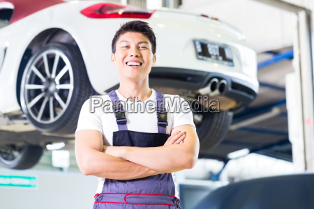 car mechanic working in asian chinese