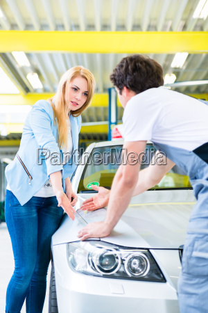 customer and car painter in auto