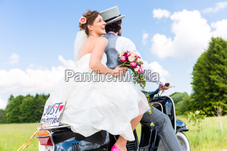 wedding couple on motor scooter just
