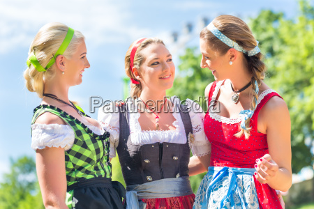 friends visiting bavarian fair having fun